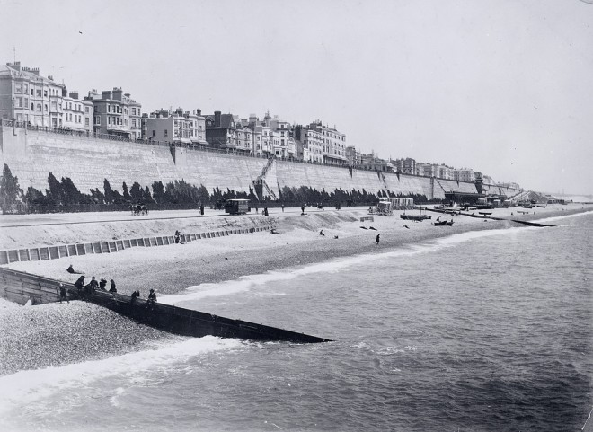 Bathing machines on the beach, c1890. Shelter hall is there, rest of terraces still be built. Royal Pavilion & Museums, Brighton & Hove
