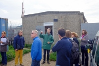 James Farrell, course tutor, talking participants through a container green roof at Organic Roofs HQ