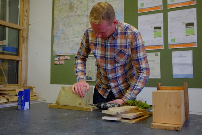 Lee Evans, course tutor, demonstrating how to build the bird box to the course participants.
