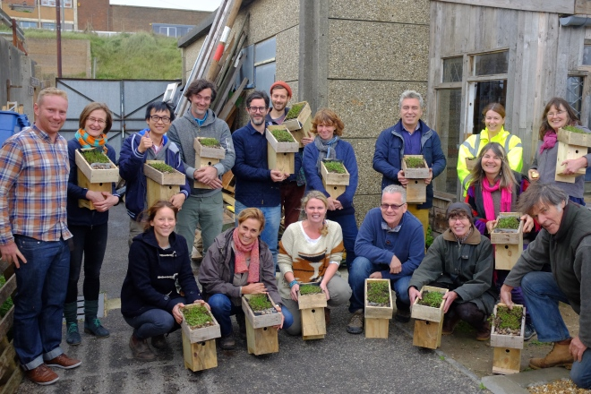 Happy green roofers with their green roofed bird boxes