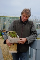 Happy course participant with their green roofed bird box