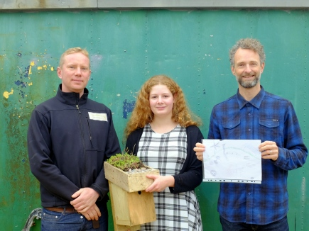 Organic Roofs and Building Green presenting the Big Nature drawing competition prize to Tamsin