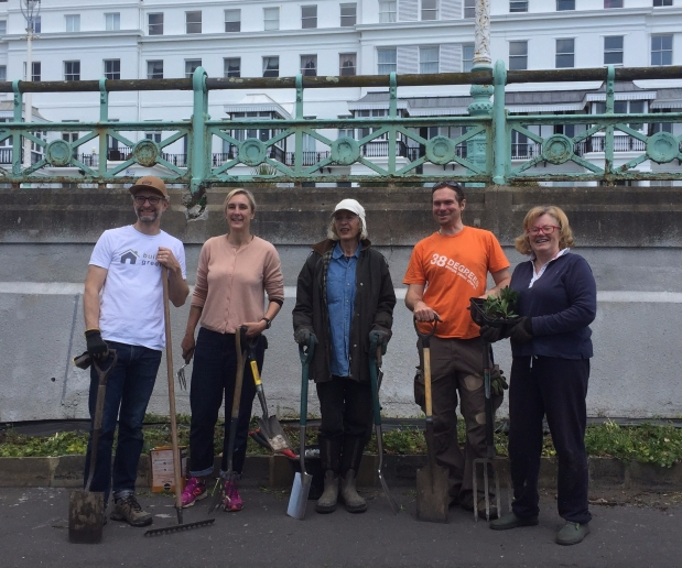 Volunteers restore oldest, longest green wall in UK